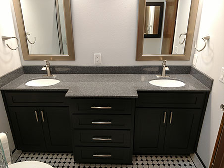 slick looking double vanity with black cabinets